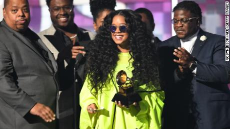 Gabriella Wilson (center), aka H.E.R., accepts the award for Best R&B Album during the 61st Annual Grammy Awards in Los Angeles, February 10, 2019.