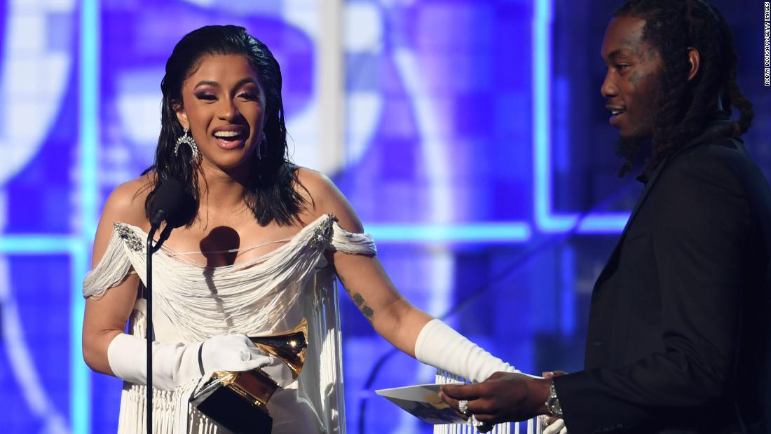 "Cardi B accepts the award for best rap album (""Invasion of Privacy"")."