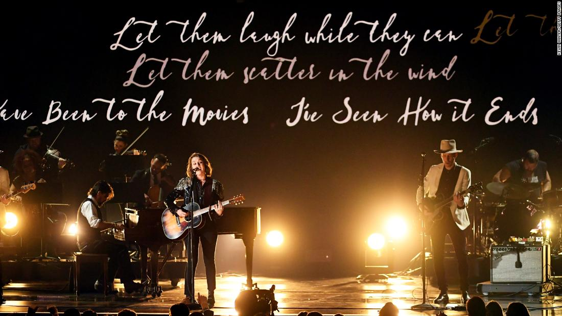 "Lyrics appear behind Brandi Carlile and Tim Hanseroth as they perform Carlile's song ""The Joke."""