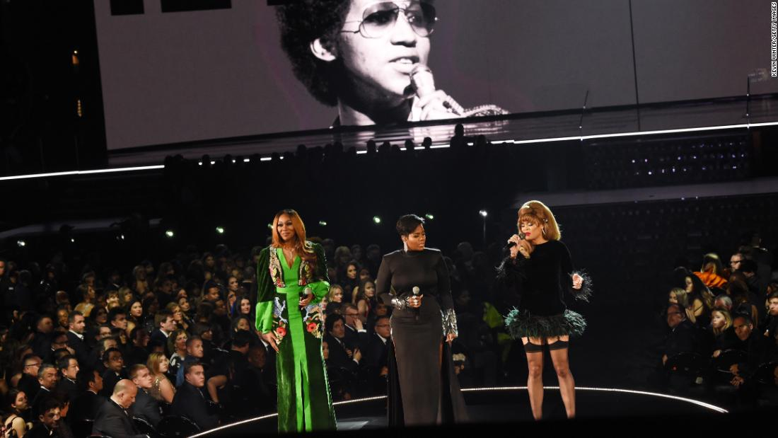 An image of the late Aretha Franklin is projected on a screen while Yolanda Adams, Fantasia and Andra Day perform a tribute.