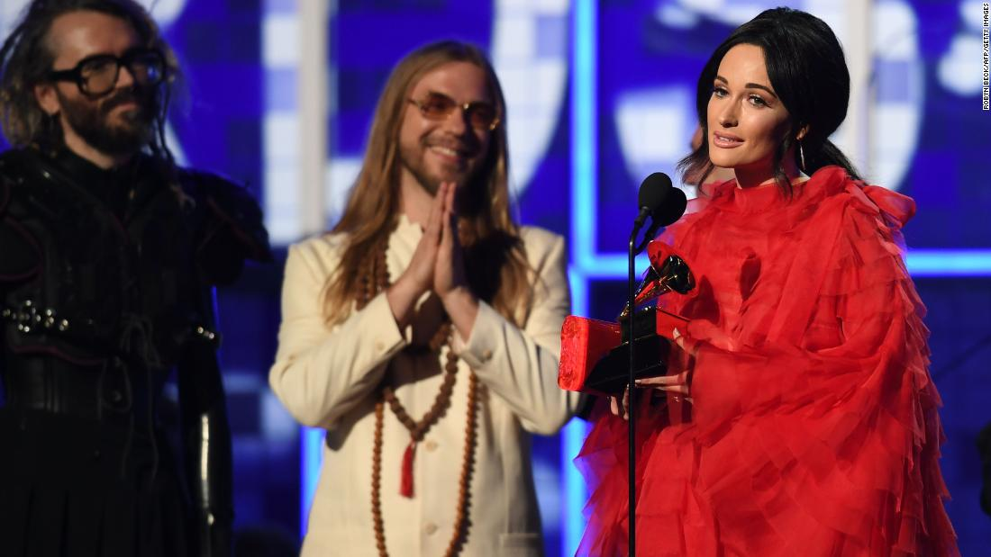 "Kacey Musgraves accepts the Grammy for album of the year. ""Golden Hour"" also won best country album."