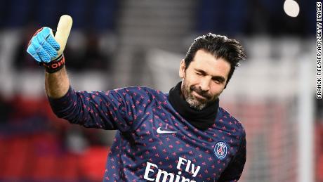 aa91ea6cc3c TOPSHOT - Paris Saint-Germain's Italian goalkeeper Gianluigi Buffon gestures  as he arrives on the