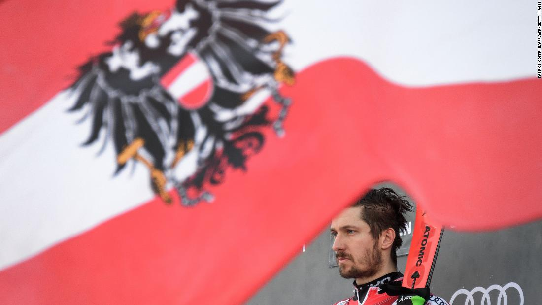 Austria's Marcel Hirscher is presented as the winner of the giant slalom race in Adelboden.