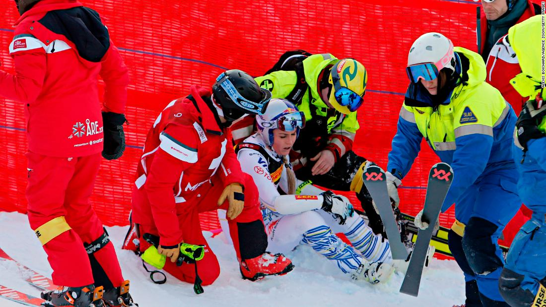 Lindsey Vonn is surrounded after a gruesome fall at the World Championships in Are.