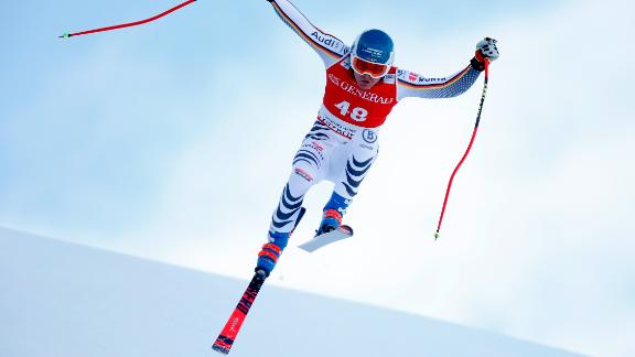 Manuel Schmid takes an insect-like leap during his super-G run at Kitzbuehel.