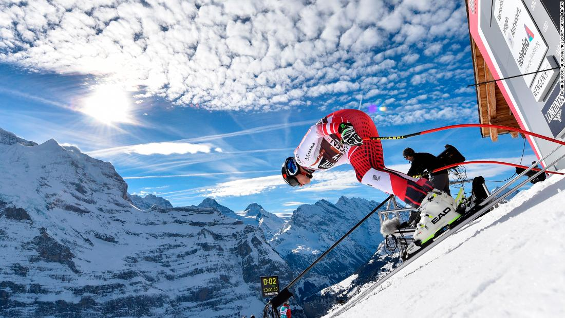Matthias Mayer steadies himself before beginning his downhill, with the clouds above him mirroring the Wengen mountains.