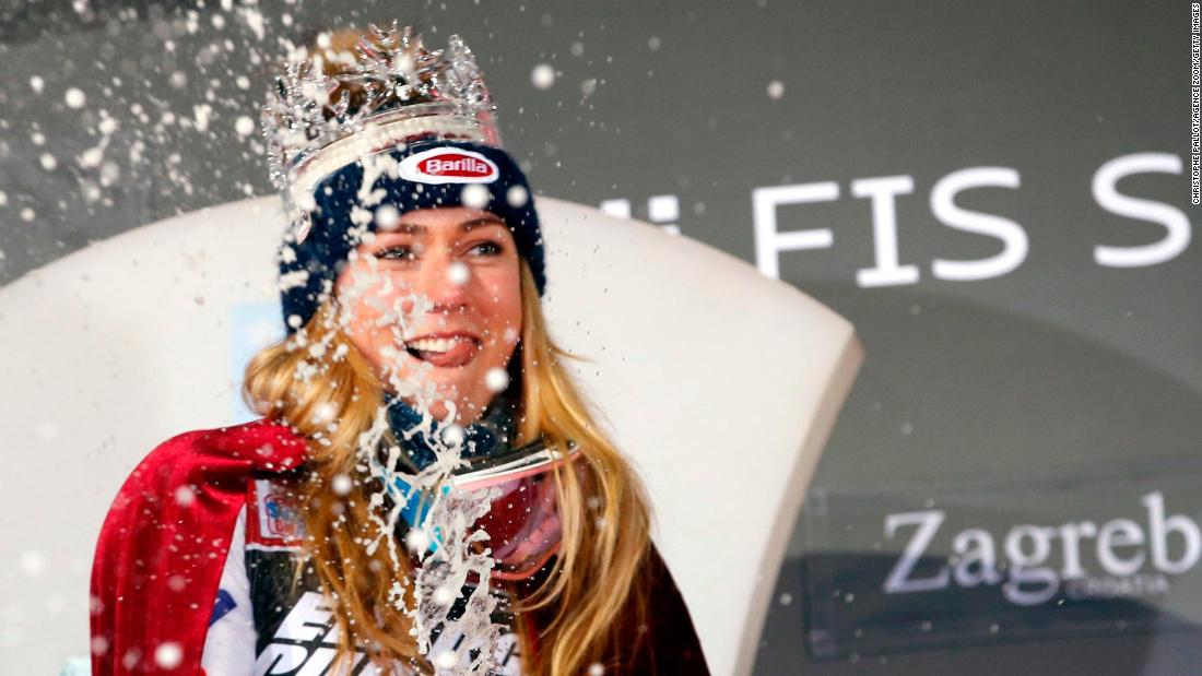 Mikaela Shiffrin celebrates with champagne and a crown after winning the women's slalom in Zagreb.