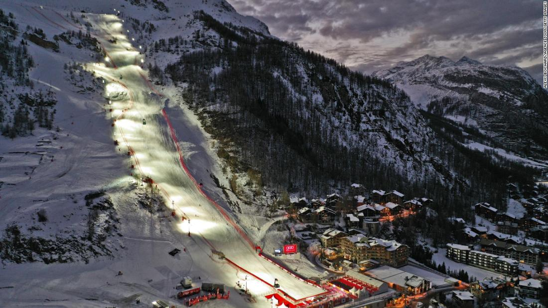 The giant slalom slope of Val d'Isère shines amid dark skies; the slalom was canceled because of bad weather.