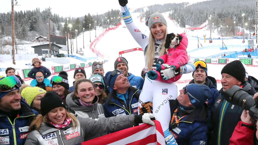 Lindsey Vonn celebrates winning World Championship bronze in the downhill in her final race before retirement.