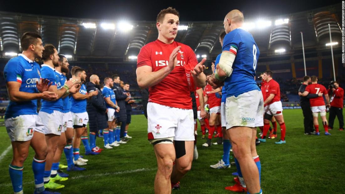 Jonathan Davies captained Wales for the first time in Rome where his side saw off Italy with tries from Josh Adams and Owen Watkin.
