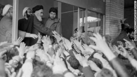 Ayatollah Rouhollah Khomeini shows the crowd at the University of Tehran after returning to Iran during the Iranian Revolution.