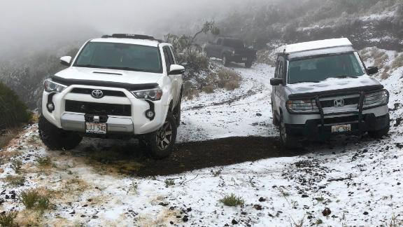 This Sunday, Feb. 10, 2019, photo shows snow on the ground in Polipoli Spring State Recreation Area in Kula, Hawaii on the island of Maui. A strong storm that hit Hawaii knocked out power, brought down tree branches, flooded coastal roads — and even brought snow. Snow is not unheard of in mountainous parts of the tropical island chain, but officials say the coating at 6,200 feet (1,900 meters) at a state park on Maui could mark the lowest-elevation snowfall ever recorded in the state. (Lance Endo via AP)