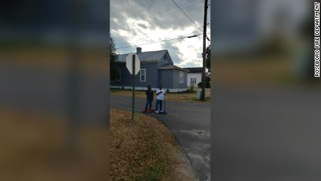 Two boys in Roseboro, North Carolina, stopped in the road and recited the Pledge of Allegiance. The Roseboro Fire Department posted the picture on Friday and it quickly went viral.