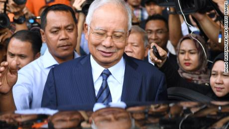 TOPSHOT - Former Malaysia's prime minister Najib Razak leaves the courthouse in Kuala Lumpur on December 12, 2018 after being charged in court. - Malaysian ex-leader Najib Razak and Arul Kanda, the former 1MDB head were charged on December 12 with altering an audit of the state fund at the centre of a scandal which helped topple the last government. (Photo by MOHD RASFAN / AFP)        (Photo credit should read MOHD RASFAN/AFP/Getty Images)