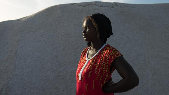 "Small-business owner Marie Diouf, known as the ""queen of iodized salt,"" oversees the iodization process at her salt flat in Fatick, Senegal, on December 2, 2018."