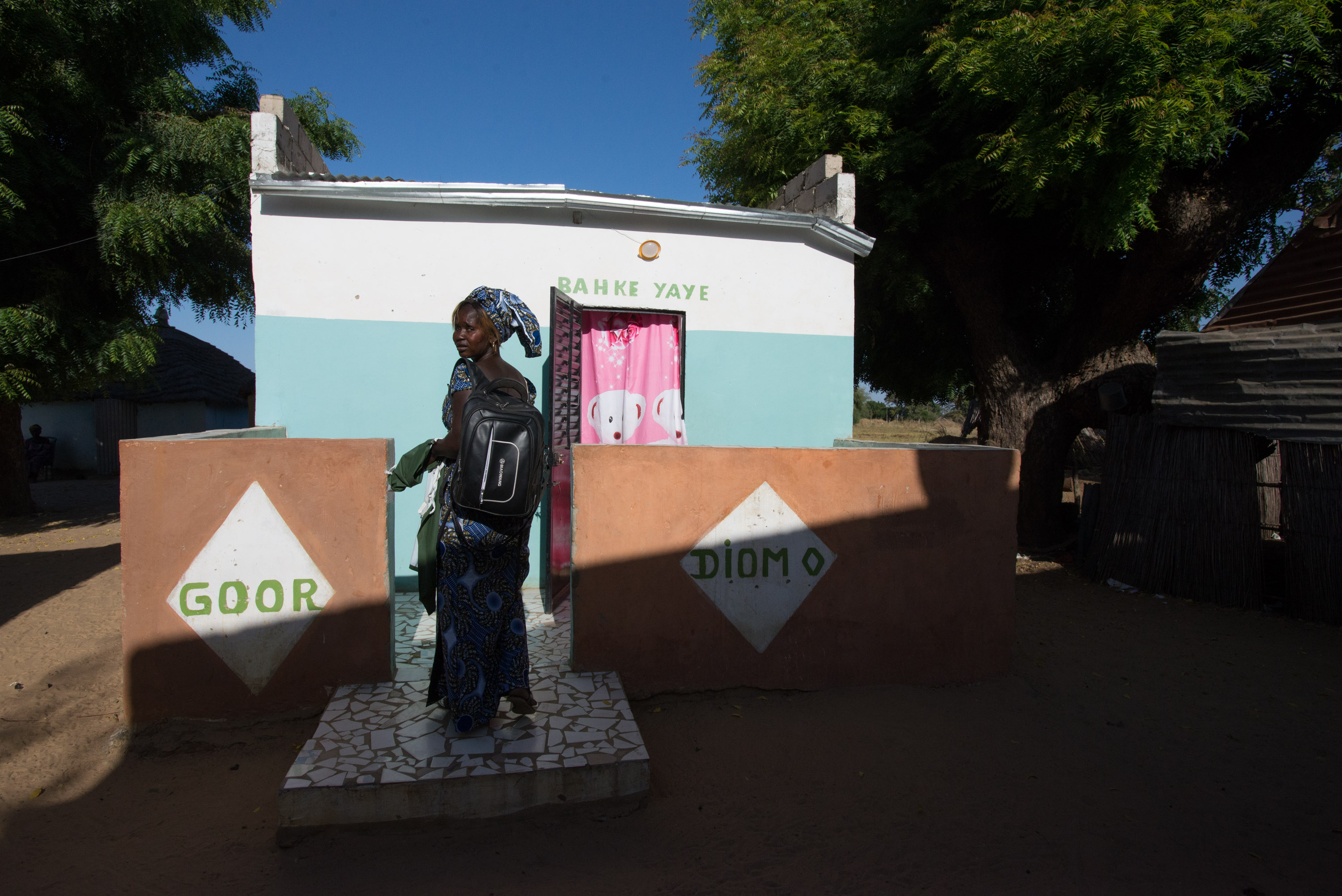 """Marie Diouf outside her home in the village of Ndiemou, which means """"Salt"""" in the local Serer language."""