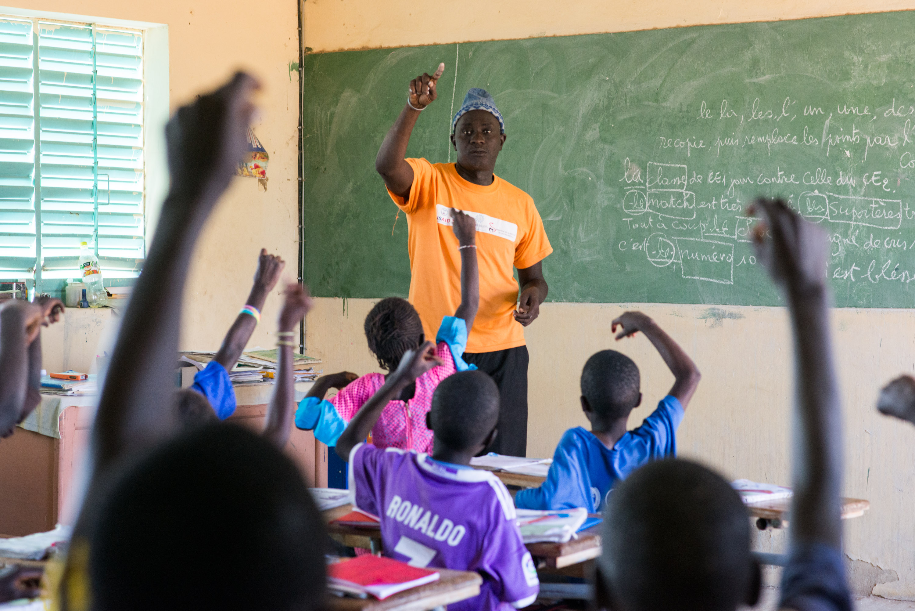 Pape Coumb Ndoffene Faye, headteacher of Ndiemou's primary school, calls on students during a French lesson.