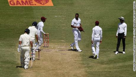 Shannon Gabriel of the West Indies exchanges words with Joe Root and Joe Denly of England.
