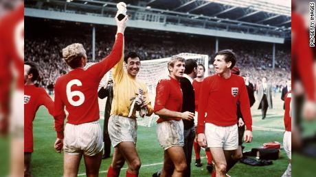 England captain Bobby Moore tries to retrieve the Jules Rimet trophy from goalkeeper Gordon Banks.
