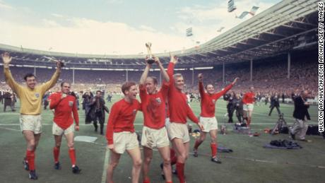Bobby Charlton raises the Jules Rimet trophy in the air  following England's 4-2 victory after extra time over West Germany.