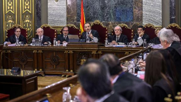 Judge Manuel Marchena (C) speaks next to magistrates during the trial of former Catalan separatist leaders at the Supreme Court in Madrid on February 12.