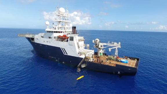 The R/V Petrel deploys its autonomous underwater vehicle (AUV). The robot can probe the ocean floor at depths more than 3.5 miles below the surface.