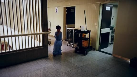 A child stands in the corridor of the Domingo Luciani Hospital in Caracas.