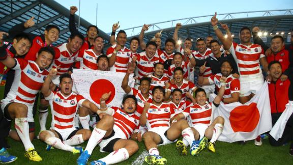 Japanese players celebrate defeating South Africa at the 2015 Rugby World Cup
