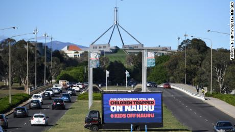 A billboard protesting against child retention in Nauru is sitting outside the Parliament building on November 26 in Canberra.