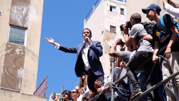 Venezuela's self-declared leader Juan Guaido addresses crowds in Caracas on Tuesday.