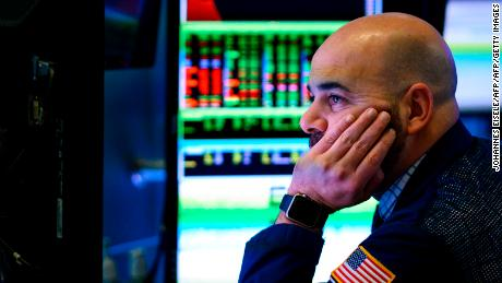 Traders and financial professionals work ahead of the closing bell on the floor of the New York Stock Exchange (NYSE) on January 29, 2019 in New York City. - Shares of large tech companies tumbled Tuesday ahead of big earnings announcements from the sector as US stocks finished a choppy session mostly lower. The tech-rich Nasdaq Composite Index finished 0.8 percent lower at 7,028.29. The Dow Jones Industrial climbed 0.2 percent to 24,579.96, while the broad-based S&P 500 shed 0.2 percent to 2,640.00. (Photo by Johannes EISELE / AFP)        (Photo credit should read JOHANNES EISELE/AFP/Getty Images)