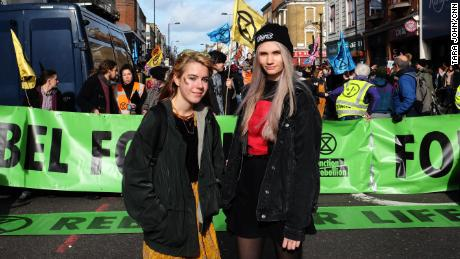 Anna Taylor, left, is trying to balance school with organizing a UK-wide student strike.