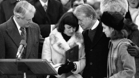 President Jimmy Carter comforts Mary Anne Dubs, widow of slain Ambassador Adolph Dubs, as Dubs