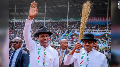 Nigerian President Muhammadu Buhari, right, greets supporters on Tuesday, February 12, 2019, during a campaign rally in Rivers State ahead of the country's presidential election.