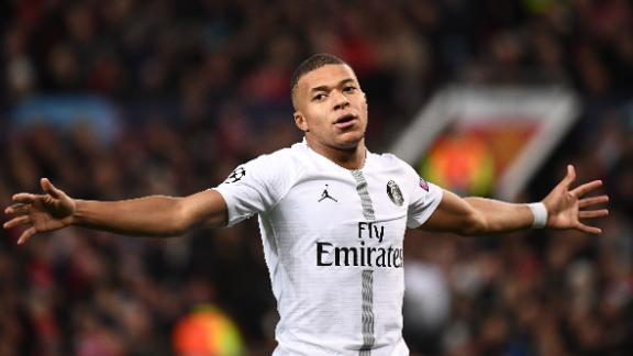 Paris Saint-Germain's French striker Kylian Mbappe celebrates scoring his team's second goal during the first leg of the UEFA Champions League round of 16 football match between Manchester United and Paris Saint-Germain (PSG) at Old Trafford in Manchester, north-west England on February 12, 2019. (Photo by FRANCK FIFE / AFP)        (Photo credit should read FRANCK FIFE/AFP/Getty Images)