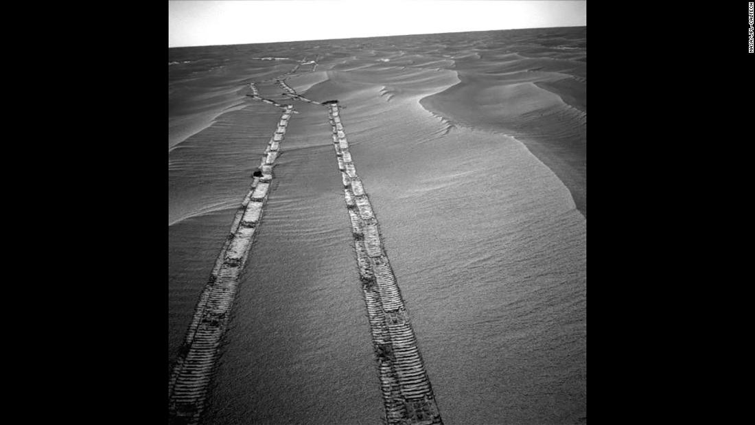 "Sometimes, when Opportunity's solar power was limited, it would stop between treks to different features on Mars. This 2010 photo of its tracks on the surface show it ""hopping from lily pad to lily pad."""