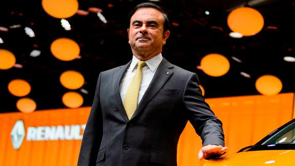 French carmaker Renault CEO Carlos Ghosn poses next to the new Renault Scenic model car at the stand of French carmaker during the press day of the Geneva Motor Show on March 1, 2016 in Geneva. / AFP PHOTO / FABRICE COFFRINI        (Photo credit should read FABRICE COFFRINI/AFP/Getty Images)