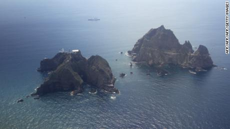 An aerial view of the remote islands disputed with Japan, known as Dokdo in Korea and Takeshima in Japan, in the Sea of Japan (East Sea) on August 10, 2012. South Korean President Lee Myung-Bak paid the unprecedented visit to the remote islands disputed with Japan, sparking anger in Tokyo which recalled its ambassador from Seoul in protest. The South has stationed a small coastguard detachment since 1954 on the islands, whose ownership has been disputed for decades between South Korea and its former colonial ruler Japan. REPUBLIC OF KOREA OUT    AFP PHOTO / DONG-A ILBO        (Photo credit should read DONG-A ILBO/AFP/GettyImages)