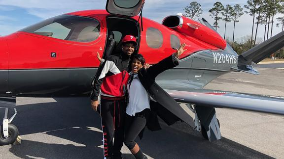 21 Savage appears with his mother after his release.