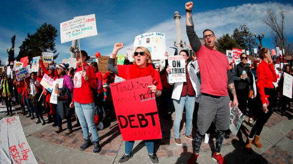 Rebecca Carlson, center, a teacher at Johnson Elementary School, joins fellow striking Denver Public Schools instructors during a rally in Civic Center Park, Tuesday, Feb. 12, 2019, in Denver. The strike, which is in its second day, is the first for Denver