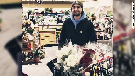 Seth Stewart's cart is loaded with 300 roses to deliver on Valentine's Day, and he will have to go back for more.