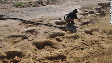 A researcher uncovers the Queensland sauropod trackway with air blaster.