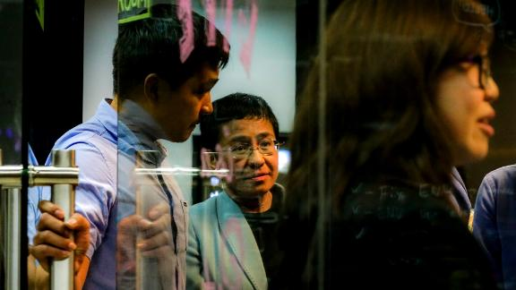Journalist Maria Ressa leaves her Manila office after she was arrested on February 13, 2019.