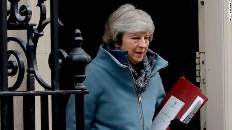 British Prime Minister Theresa May leaves 10 Downing Street in London to attend Prime Minister's Questions at the Houses of Parliament on Wednesday.