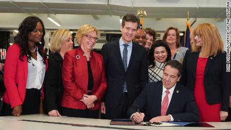 Gov. Andrew Cuomo signs the Child Victims Act in the newsroom of the New York Daily News.