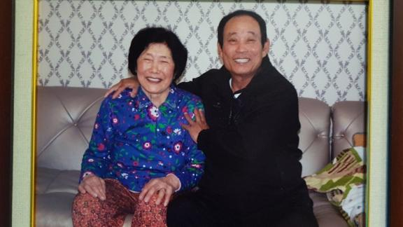 Kim Sin-yeol, the sole permanent resident of the South Korean-administered Dokdo Islands, with her late husband. The islands are called Takeshima by Japan, which also claims ownership.