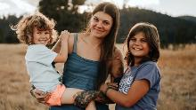 Stephanie Land (center) with her daughters Coraline (left) and Mia (right).