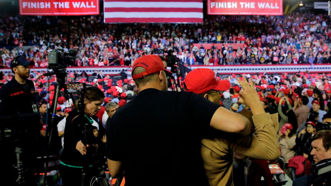 A man is restrained after he attacked a BBC photojournalist who was covering President Donald Trump's rally in El Paso, Texas, on Monday, February 11. The man had gained access to an area designated for the news media and began shoving people, according to video of the incident.