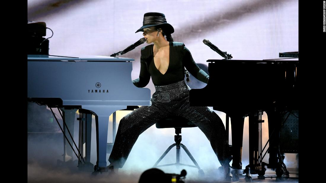 Grammys host Alicia Keys plays two pianos at once after coming back from a commercial break on Sunday, February 10. It was one of the many standout moments for Keys, who was the first female host of the show in 14 years.