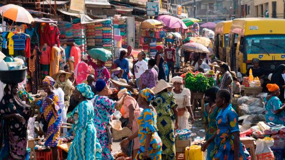 People walk through Balogun market in streets around Lagos Island on May 5, 2017.  Lagos is the world's 10th largest city with between 17 and 22 million people, although no-one seems to be counting.  / AFP PHOTO / STEFAN HEUNIS        (Photo credit should read STEFAN HEUNIS/AFP/Getty Images)